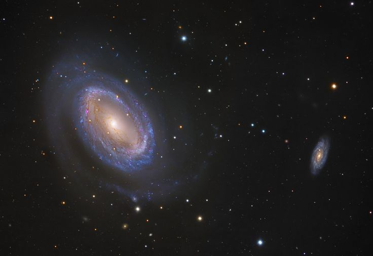 While most spiral galaxies, including our own Milky Way, have two or more spiral arms, NGC 4725 has only one. In this sharp color composite image, the solo spira mirabilis seems to wind from a prominent ring of bluish, newborn star clusters and red tinted star forming regions. The odd galaxy also sports obscuring dust lanes a yellowish central bar structure composed of an older population of stars.