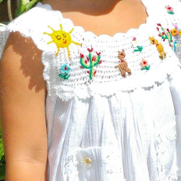 http://www.babatude.com/media/catalog/product/l/i/littleinca_crochet-detail.jpg