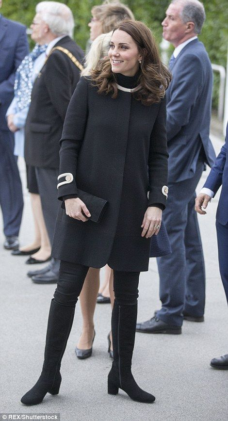Today, Kate donned a cosy polo neck jumper underneath the collarless coat to keep warm... Nov 22 2017, black Goat coat, third pregnancy