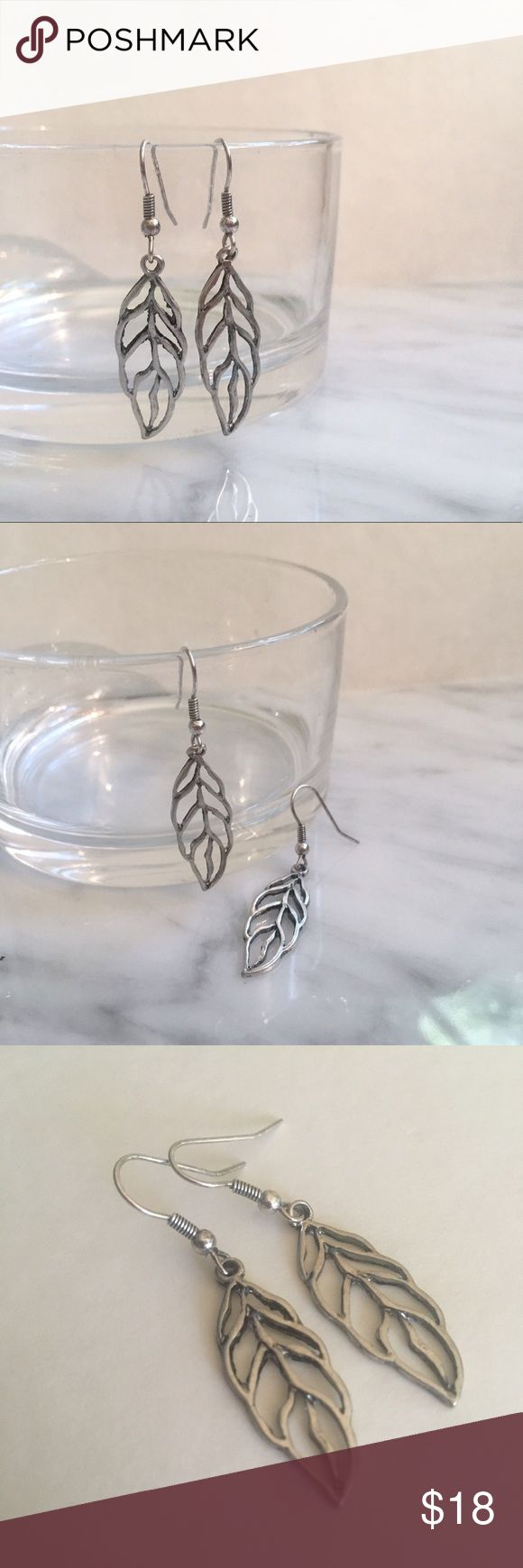 "Chic & Delicate Boho Leaf Cut-Out Dangle Earrings Gorgeous delicate filigree Leaf cut-out style dangle earrings.  Shepard's hook back. Chic and dainty statement earring. Metal leaf approx 1.5."" EXCELLENT condition, never worn! Purchased at Pike Place Market in Seattle. Jewelry Earrings"