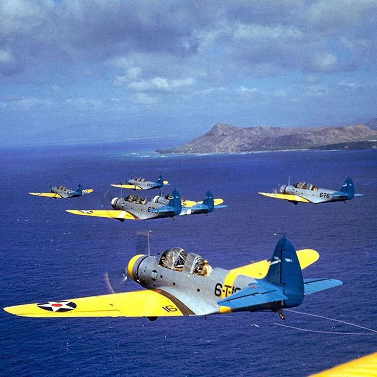 Squadron of American Douglas torpedo bombers from the aircraft carrier USS Enterprise CV-6 in flight near Diamond Head, Oahu - Hawaii, in 1941. (Carl Mydans—The LIFE Picture Collection/Getty Images)