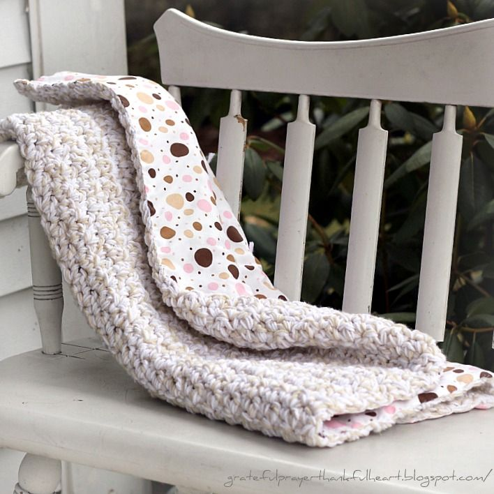 Love this idea...line the back of your knit blanket with flannel to make it warmer and protect baby fingers from getting caught