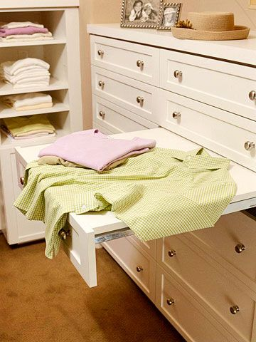 Pull-out drawer provides a flat surface for folding clothes and/or drying delicates (via BGH) #closet #dressing_room #organization