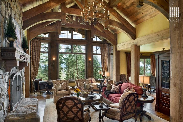 Rustic Great Room with stone fireplace, Exposed beam, Wall