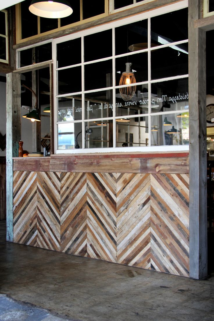 The chevron wall is built of plaster lath from Brooklyn, and the windows were rescued from various homes. The salvaged beams were installed and notched by hand.