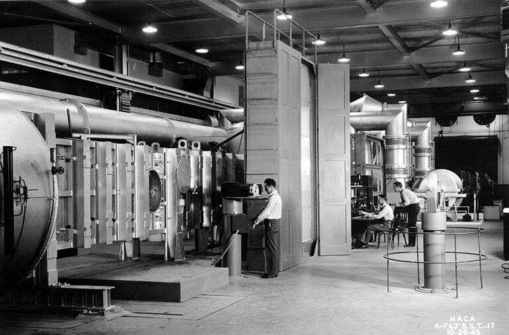 Interior view of the Schlieren setup in the 1 x 3 Foot Supersonic Wind Tunnel at the NACA Ames Aeronautical Laboratory, Moffett Field, California, 26 October 1945, public domain via Wikimedia Commons.