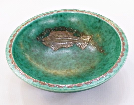 Gustavsberg Argenta Ware bowl designed by Wilhelm Kage, footed base, decorated with silver fish to interior and scalloped edge against mottled green ground, printed marks to base, 17.8cm diameter Estimate £100.00 to £150.00 (Lot no: 51 in sale on 05/08/2014) The Cotswold Auction Companyu