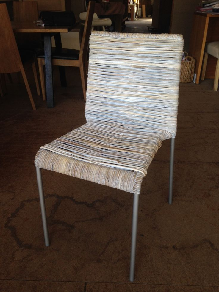 The cane whitewash dining chair for sale at Wildflower Furniture