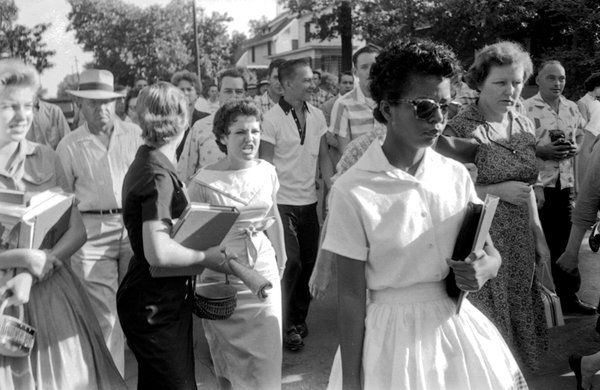 """Will Counts """"First Day of School in Little Rock"""" Sept 4, 1957 This picture is important because it shows a major milestone for the United States as it integrates schools for the first time in history.   Hazel Bryan and Elizabeth Eckford, Little Rock, Ark., September 1957 by Will Counts"""