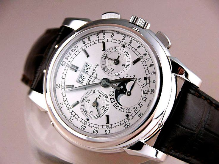 Patek Philippe Reference 5970. Clapton sports one. Charlie Sheen's was stolen during a coke-binge. Costs as much as a luxury German sports coupe.