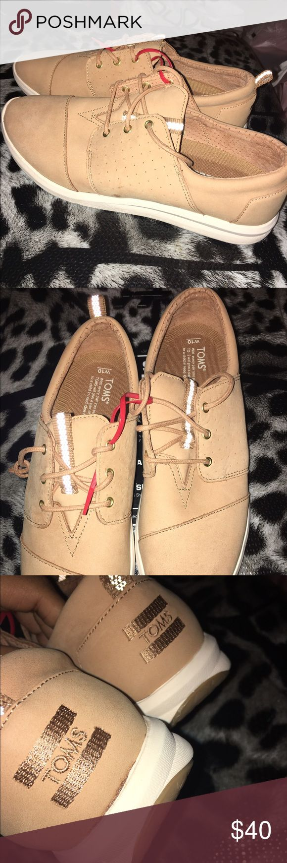 Toms Khaki Shoes BNWT Beautiful pair of Toms with a Yeezy vibe. Have reflective tongue and is a very cute yet comfortable pair of shoes. TOMS Shoes Sneakers