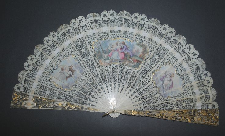 Brisé fan of what appears to be ivory, gilded, and painted, with several inset scenes. English c1800. From eBay. (Wish I could afford it!)