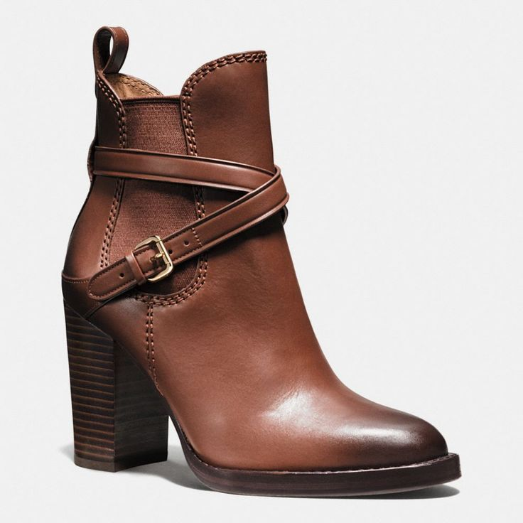 Equestrian-inspired belting wraps these beautifully crafted booties made of rich, vegetable-tanned leather, while a high stacked heel takes the design from riding ring to runway. Elastic goring and a pull-loop in back make them easy to slip on and off.