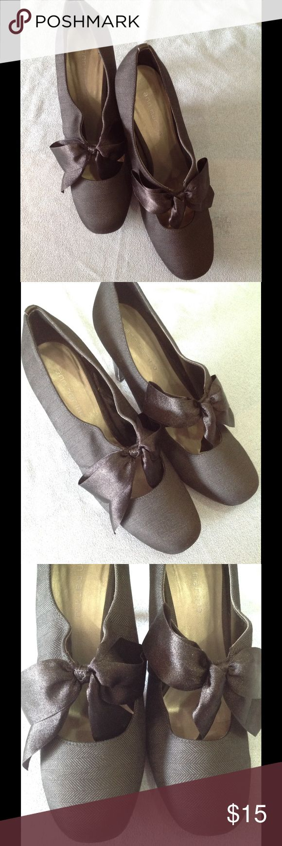 Adorable Black Heels with Satin Bows Size 8.5 These shoes are so simple and yet very stylish!! The satin bow adds an elegant flair! Ann Marino Shoes Heels