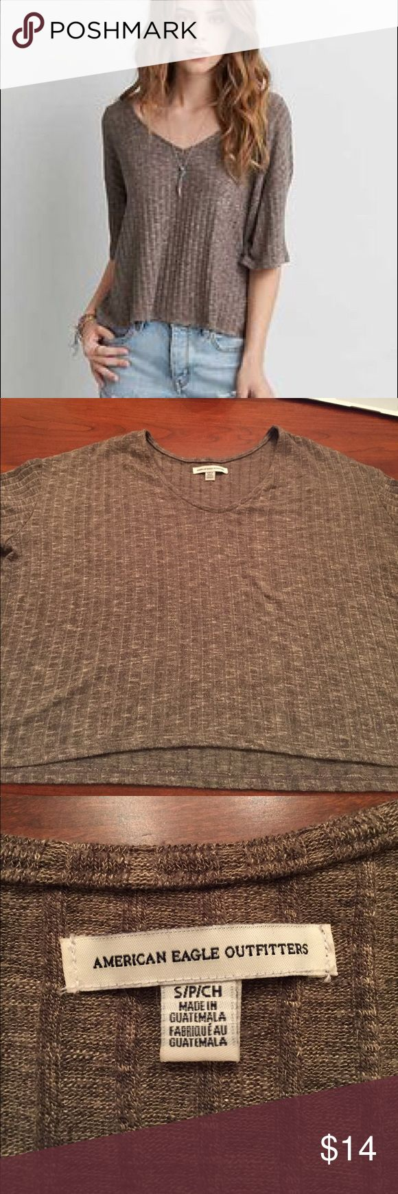 """American Eagle Sweater Flowy Tshirt Flowy tshirt that is sweater material. On my 5'8"""" body and long torso, slightly turned into a crop top. Very soft and comfy material. Flattering neckline. Rarely worn American Eagle Outfitters Tops Tees - Short Sleeve"""