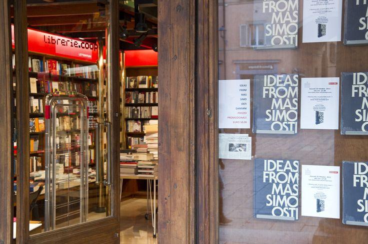 """The book """"Ideas from Massimo Osti"""" in the shop windows Feltrinelli, historical library Nicola Zanichelli, publisher and printer. Piazza Galvani, Bologna"""