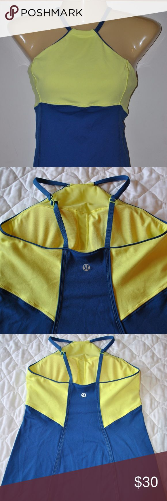 """LULULEMON two toned adjustable strap fitted tank Neon yellow top and royal blue bottom with adjustable strap. Removable padded lined bra. 14"""" pit to pit, 13"""" waist across, 17"""" pit to hem. Measurements are taken laying flat without any stretch. Smoke and pet free home. Let me know if you have any questions. Have a great day. lululemon athletica Tops Tank Tops"""