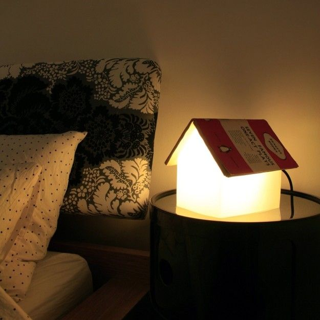 A bedside lamp that doubles as the bookmark you need when you start to drift off. | 21 Things That Will Make Your Bedroom Even Cozier