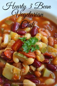 This three bean vegetarian chili recipe is a simple and healthy solution for weekday dinners. You can make it on the stovetop in a quick 30 minutes, or you can let it simmer all day in the slow cooker. Either way, it is the best veggie chili! The instructions also include a recipe for making homemade chili seasoning. Save this easy dinner today!
