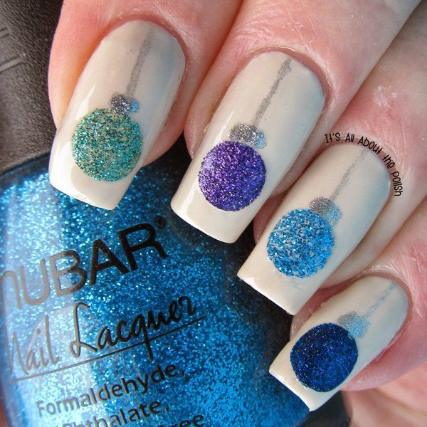 Sparkly nail art design perfect for the fall season with a white matte background and cool colored crystal balls in glitter polish.