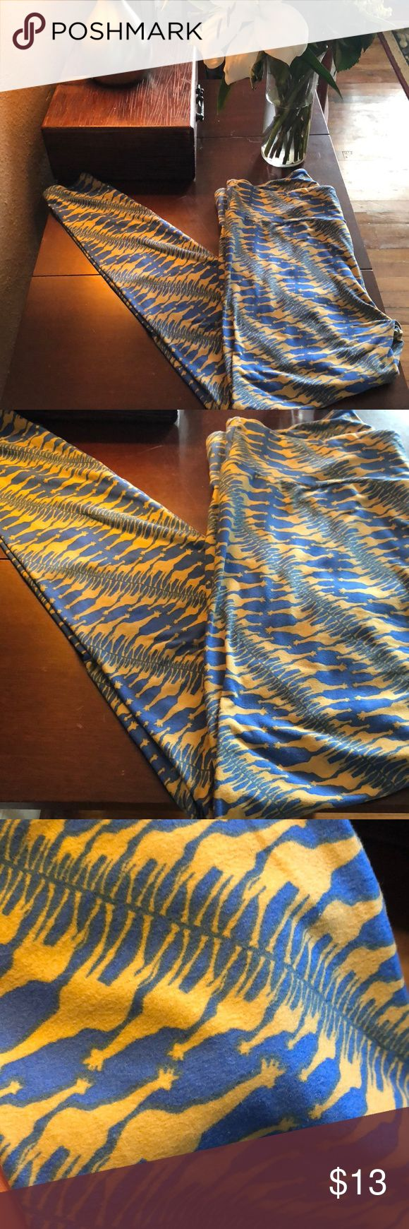 Lularoe giraffe blue and buttercup yellow leggings TC Lularoe giraffe blue and buttercup yellow leggings. EUC. Worn only a handful of times. LuLaRoe Pants Leggings