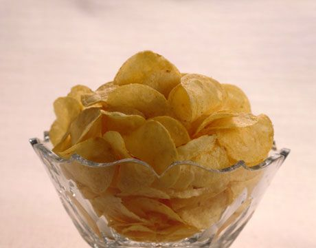 """""""When I was in Italy one summer, our hosts served cashews and potato chips in crystal bowls while we sipped Prosecco. It was a revelation: right-out-of-the-bag snacks become sophisticated when they're served in a gorgeous dish."""" —Stephanie Ballard, covetliving.com   - HouseBeautiful.com"""