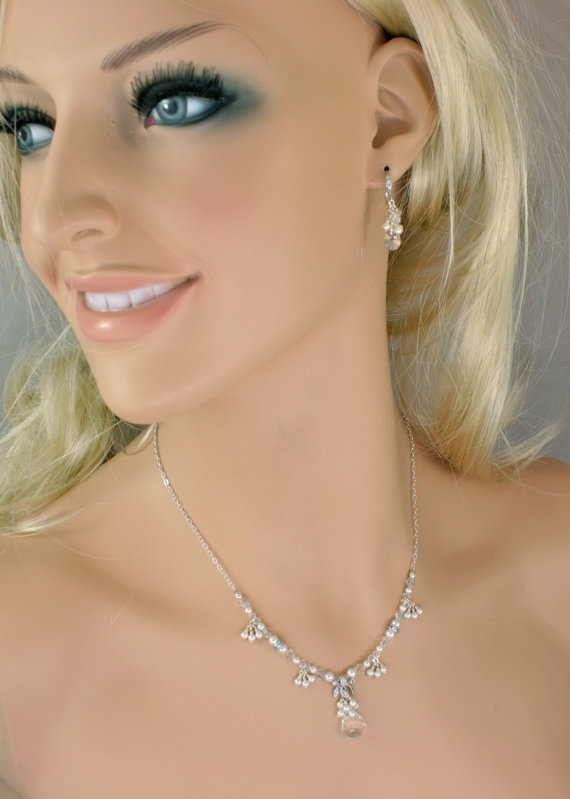 Try and get past the super CREEPY picture.  Bridal Wedding Set Pearl and Crystal Wedding by LizardiBridal, $135.00