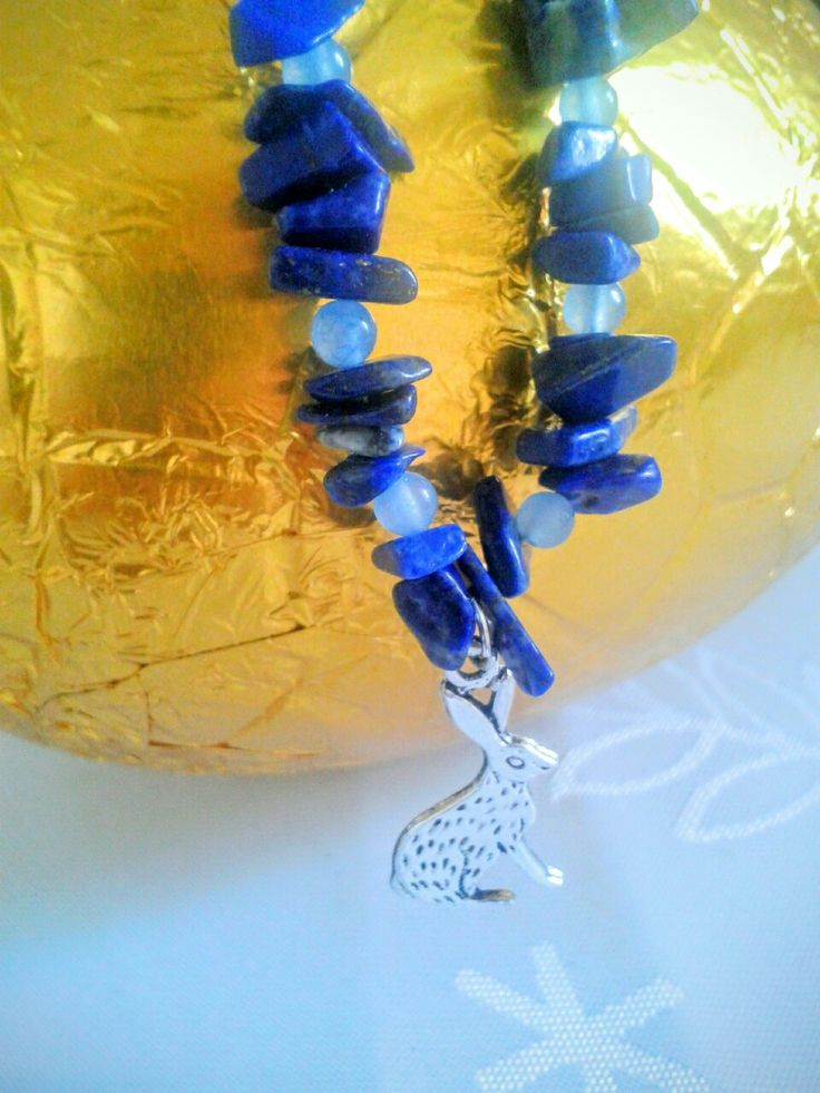This a a lapis lazuli and rainbow moonstone hare necklace. Happy Easter!