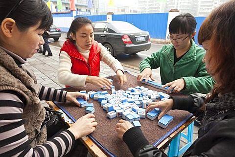 Women playing Majiang, Mahjong, Chinese board game, on the street, Chongqing, People's Republic of China