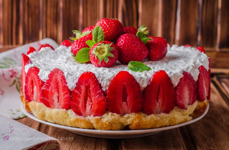 no baked Strawberry Cheesecake with cottage cheese on wooden background selective focus. by beautifultania
