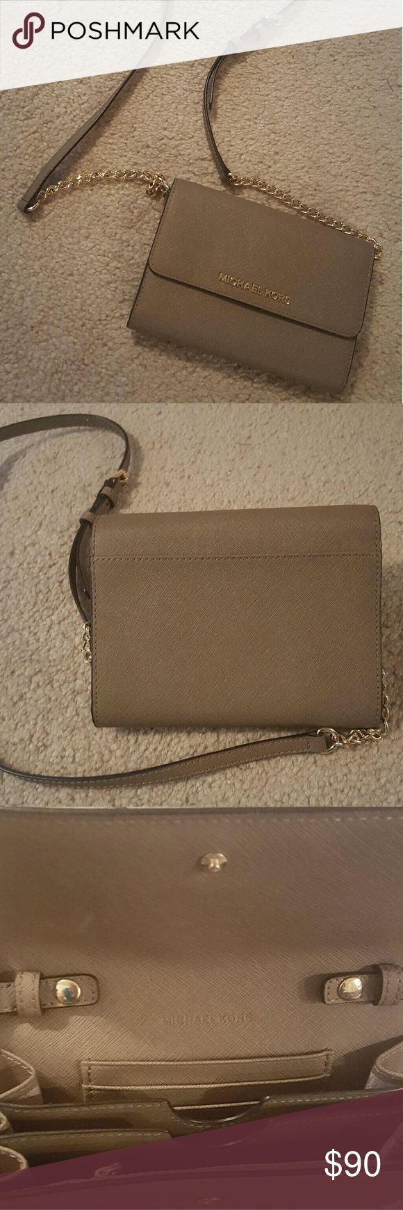 Michael Kors new clutch wallet with chain Clutch with removable wallet is super versatile. Take off the straps and use as a wallet or use it cross body when going out at night! Convenient sloths for credit cards, cash, your phone and even some lip gloss! Never been used. Michael Kors Bags Clutches & Wristlets