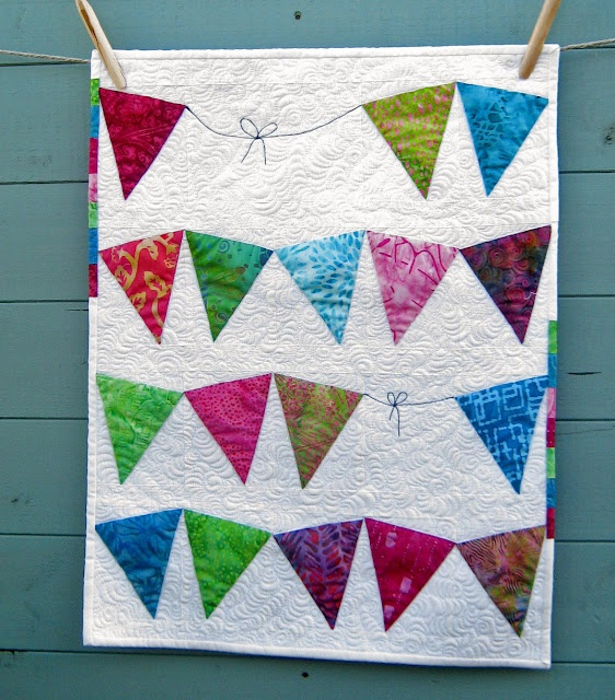 Pieced (not appliqued) bunting quilt.