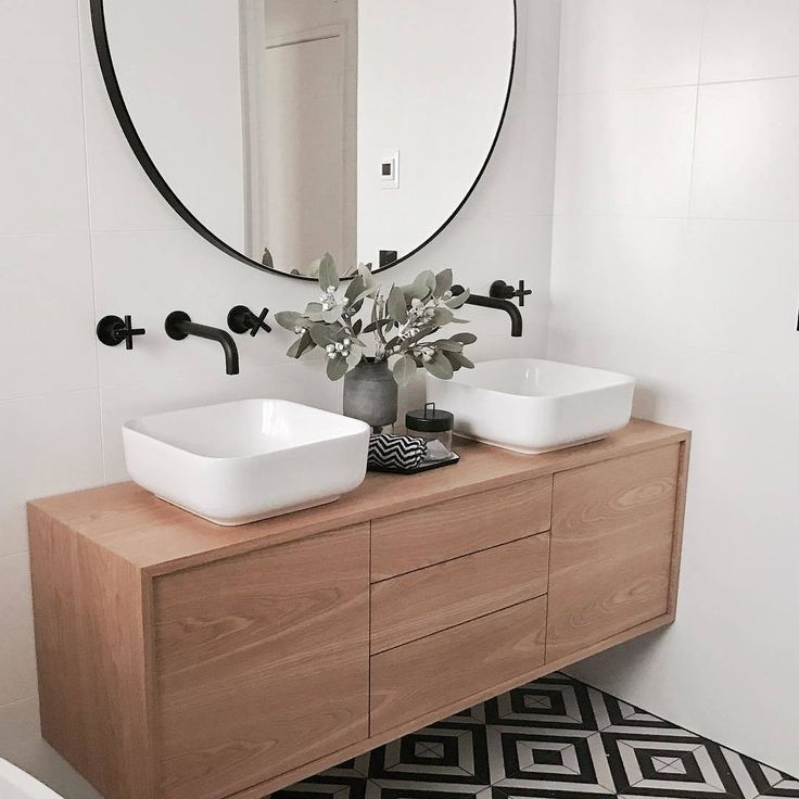 What an incredible outcome! We love the use of the oversized, modern, round mirror above our matte black wall tap assemblies and spouts in this elegant space by @mintinteriordesign!