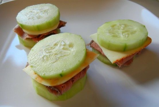 0 Carb Snacks Quest Cucumber Sandwiches What: Slices of Cucumber,  deli meat and cheese  How: Cut down  deli meat & cheese to approximate size of cucumber slice. Stack and enjoy !