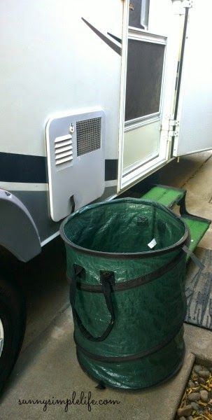Pop up trash can makes the best laundry hamper for camping. No dirty clothes and wet towels in the rv or tent. Must Do Camping Hacks @sunnysimplelife.com #camping #rv #trailer
