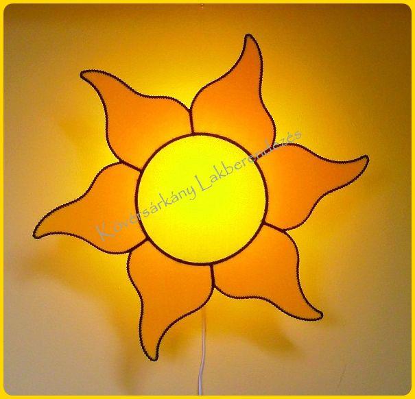 PLÜSS NAPOCSKA Napfény, vidámság, életöröm. Melegséget és Fényt ad kívül és belül egyaránt.  Méretei: 58 cm az átmérője. Ára ufólámpatesttel: 10.000 Ft