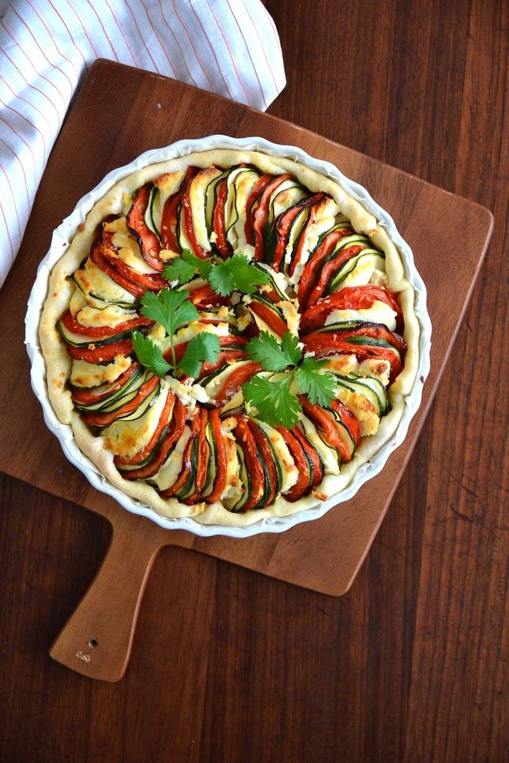 Vegetable tart wiith alternating slices of zucchini, tomato, and chevre ... yum!