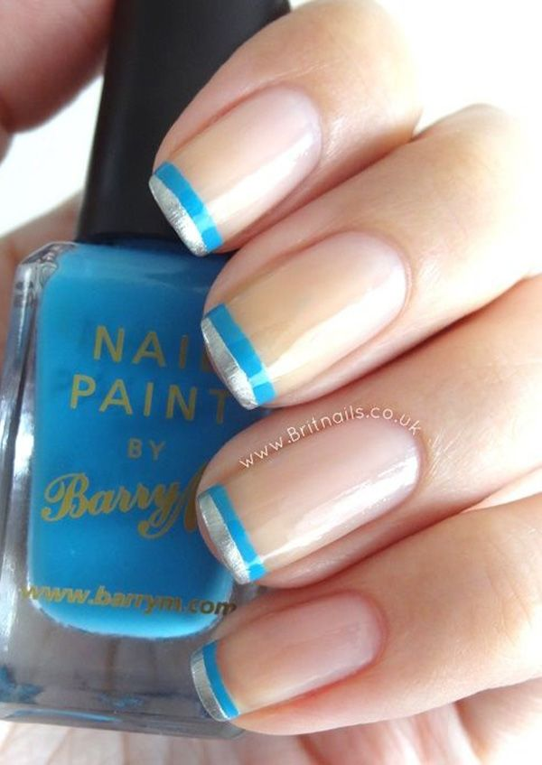 Silver and blue French tips. Keep it simple and paint two strips of the blue and silver nail polish to complete your French tip.