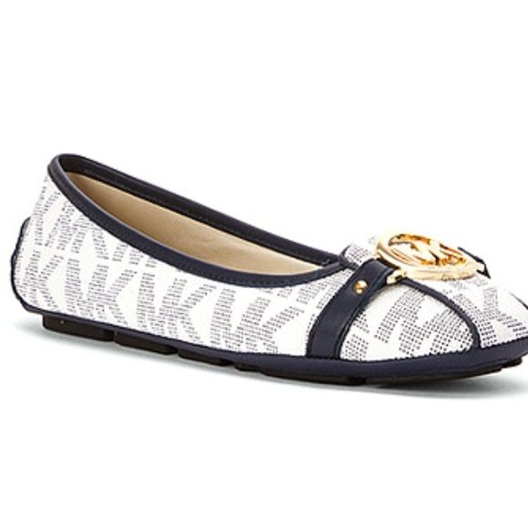 Micheal Kors Navy Blue and White Flats Authentic Micheal Kors flats. Only worn twice. Leather has not loosened up. Still feels like a brand new pair of shoes. Size ten. Box included. Michael Kors Shoes Flats & Loafers