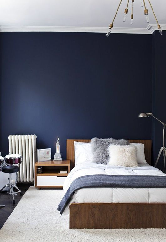 Gorgeous combination of deep denim blue and warm timber tones.