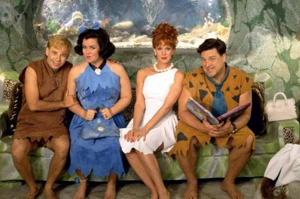 Meet the Flintstones-Barney Rubble (Rick Moranis), Betty Rubble (Rosie O'Donnell), Wilma Flintstone (Elizabeth Perkins), and Fred Flinstone (John Goodman). 2