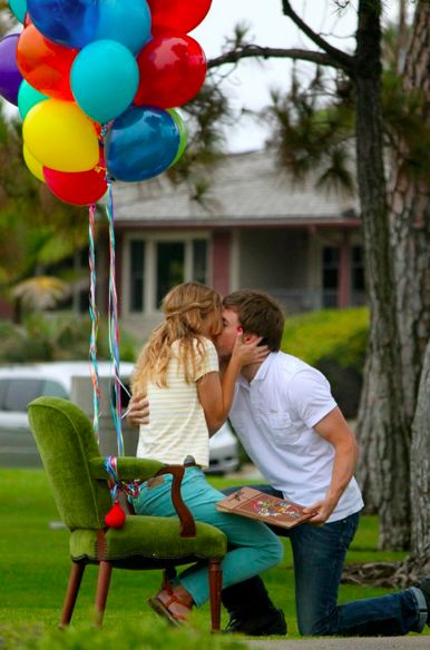 Up proposal -  he sat her in a chair loaded with balloons and then gave her a personalized adventure book for the two of them. Proposing: You're doing it right.