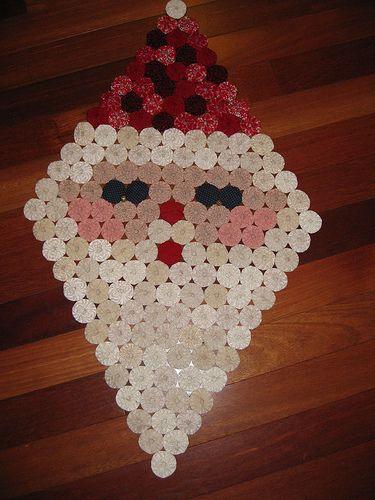 Yoyo Santa! - cloth circles called yoyo's arranged to make a santa face.