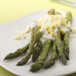 Roasted Asparagus with Garlic-Lemon Sauce:  89 calories; 4 g fat ( 1 g sat , 2 g mono ); 4 mg cholesterol; 10 g carbohydrates; 0 g added sugars; 6 g protein; 4 g fiber; 282 mg sodium; 464 mg potassium.