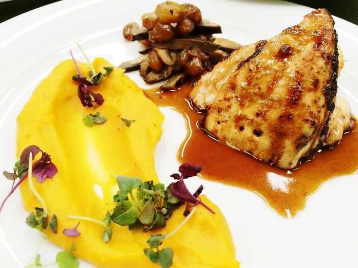 Free ranged chicken with grilled mushrooms, sweet potato puree, caramelized onions and thyme sauce.