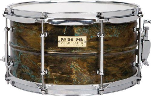 Pork Pie Snare Drum 7x13 Brass Shell Custom Patina Finish Chrome Tube Lugs by Pork Pie. $249.99. Pork Pie has been making waves in the drum industry with their unusual, innovative products. The Pork Pie Brass Shell Custom Patina Finish Chrome Tube Lugs is a good example of this, with retro-style tube lugs that traverse the depth of the body, and a brass shell with a stunning Custom Patina Finish. Outstanding sensitivity, volume, and projection.
