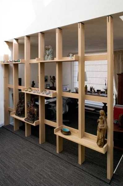Basic construction room divider with shelves. Could place a roll down shade or pull a curtain across the back to provide privacy in a bedroom area.