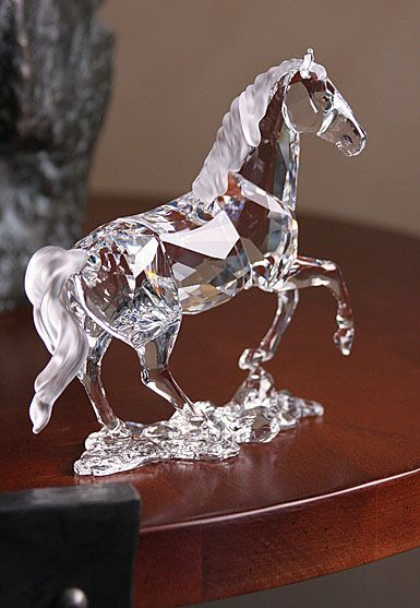 Swarovski Stallion - The large clear crystal figure has Topaz crystal eyes. Its mane and tail and base are in unfaceted matt crystal.