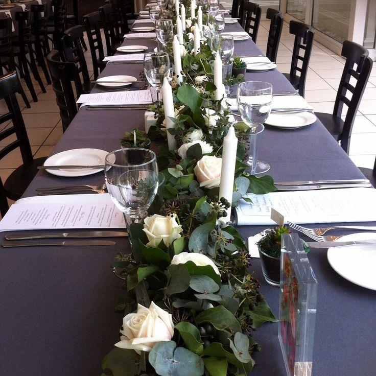 Lush fresh table runner of ivy, gum, fragrant roses and ranunculus.