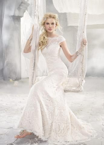 Alvina Valenta 9258 is a French corded lace over rum pink silk faced duchess. It features a bateau neckline and low V back. This gown came from a designer bridal boutique and is in excellent condition. Alvina Valenta 9258 is Ivory/Rum Pink and a size 14.